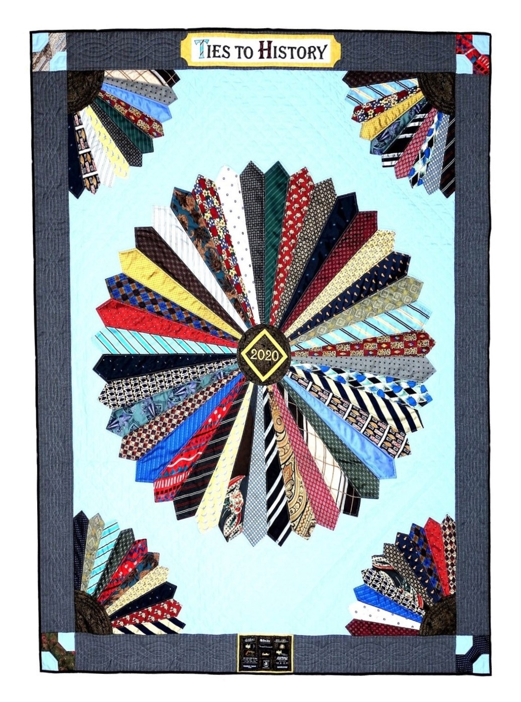 Quilt made by Beverley Bennett for the Ties to History exhibition. The main part of the quilt is made of men's ties.
