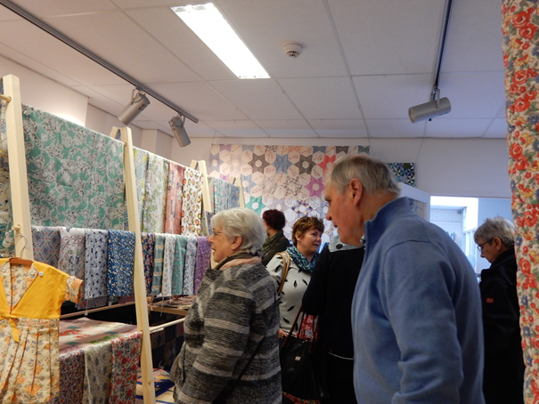 Participants to the feedsack and quilt week, inspecting the items on display. Photograph by Shelley Anderson.